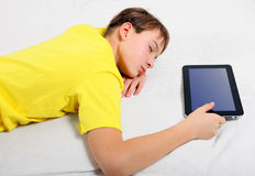 Kid sleep with Tablet Computer Royalty Free Stock Image