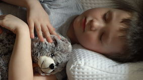 Kid sleeping stock video footage