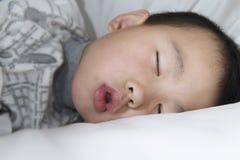 Kid sleeping Stock Images