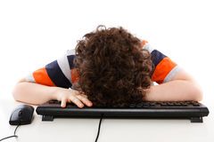 Kid sleeping on comuputer keyboard Stock Image