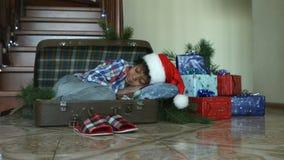 Kid sleeping inside cozy suitcase. stock footage