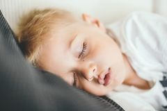 Kid sleeping on a sofa. royalty free stock images
