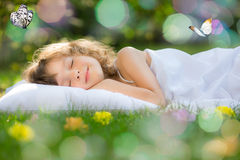 Kid sleeping in spring garden Royalty Free Stock Image
