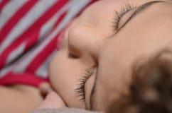 Kid sleeping sweet. Kid sleeping closeup of eyes royalty free stock image
