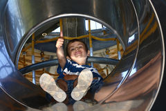 Kid in a slide Stock Images