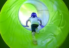 Kid sliding into a tunnel Stock Photos
