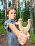 Kid with slingshot Royalty Free Stock Photography