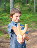 Kid with slingshot Stock Photos