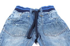 Kid small blue jeans. Blue jeans  on white background Stock Image