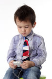 Kid with smart phone Royalty Free Stock Photos