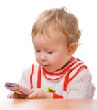 Kid with a smartphone. In the hands on a white background Royalty Free Stock Photos