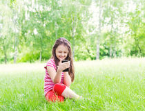 Kid and smartphone Royalty Free Stock Images