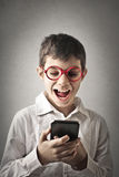 Kid with smartphone Royalty Free Stock Images