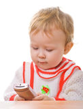 Kid with a smartphone on white. Kid with a smartphone in the hands on a white background Royalty Free Stock Images