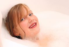 Kid smile in bath Royalty Free Stock Photos