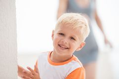 Kid smiles and play on terrace royalty free stock image