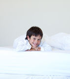 Kid smiling in a bed Royalty Free Stock Photography