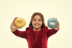 Kid smiling girl ready to bite donut. Sweets shop and bakery concept. Kids huge fans of baked donuts. Can you resist. Fresh made to order donut. Girl hold royalty free stock photo