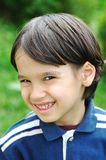 Kid smiling and looking Royalty Free Stock Photo