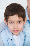 Kid smiling to the camera Royalty Free Stock Images