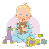 Kid smiling with toys Royalty Free Stock Photos