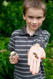 Kid with snails Stock Photos