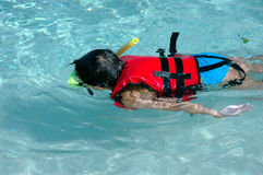 Kid snorkeling stock photography
