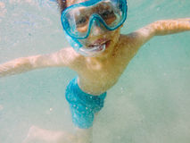 Kid snorkeling. Underwater, wearing mask and tube stock images