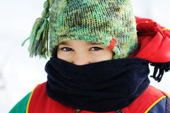 Kid in snow Stock Photo