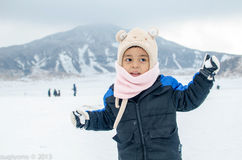 Kid with snow in Mount ASO Royalty Free Stock Image