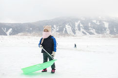 Kid with snow in Mount ASO Stock Images