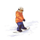 Kid on snowboard. Kid slide with snowboard in the snow Royalty Free Stock Image