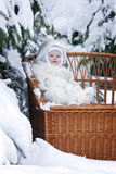Kid with snowy branch on winewomen bench Royalty Free Stock Photography
