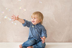 Kid with soap bubbles Royalty Free Stock Photo