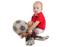 Kid with a soccer ball. He is very happy. Little baby is playing with a football. He is very happy royalty free stock images