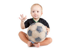 Kid with a soccer ball. He is very happy. Little baby is playing with a football. He is very happy royalty free stock photography