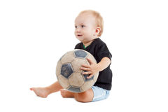 Kid with a soccer ball. He is very happy. Little baby is playing with a football. He is very happy stock photos