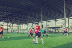 Kid soccer juggling football. BANGKOK, THAILAND - MAY 6, 2018 : Kids enjoy training and playing soccer on holiday at TC football club Rama 3 Stock Photography