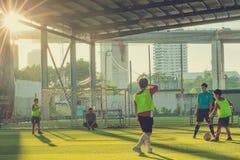 Kid soccer juggling football. BANGKOK, THAILAND - MAY 6, 2018 : Kids enjoy training and playing soccer on holiday at TC football club Rama 3 Stock Photo