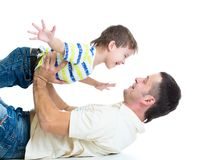 Kid son and dad having fun pastime. On white background Stock Photography