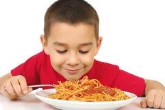Kid and spaghetti stock image