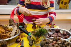 Little child creating autumn decorations Royalty Free Stock Photo