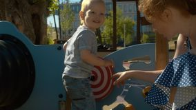 Kid spinning hypnotic circle. In the park on the playground stock video footage