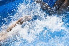Kid splashing in the pool Royalty Free Stock Photography