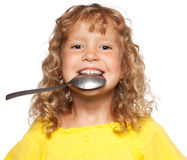 Kid with spoon Stock Photo