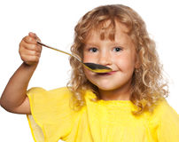 Kid with spoon Royalty Free Stock Image