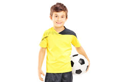 Kid in sportswear holding a soccer ball Royalty Free Stock Photography