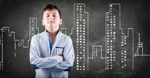 Kid stading in front of a urban city Royalty Free Stock Image
