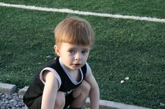 The kid in stadium Stock Photo