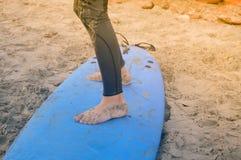 Feet on surfboard stock image